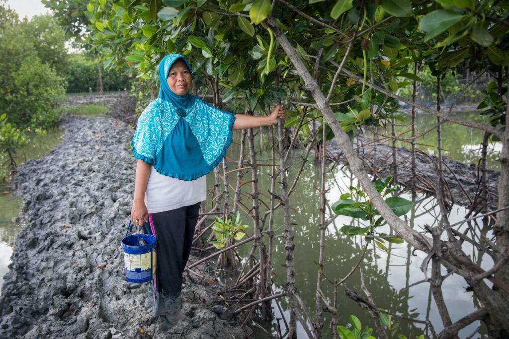 Aquaculture farmer at her farm.